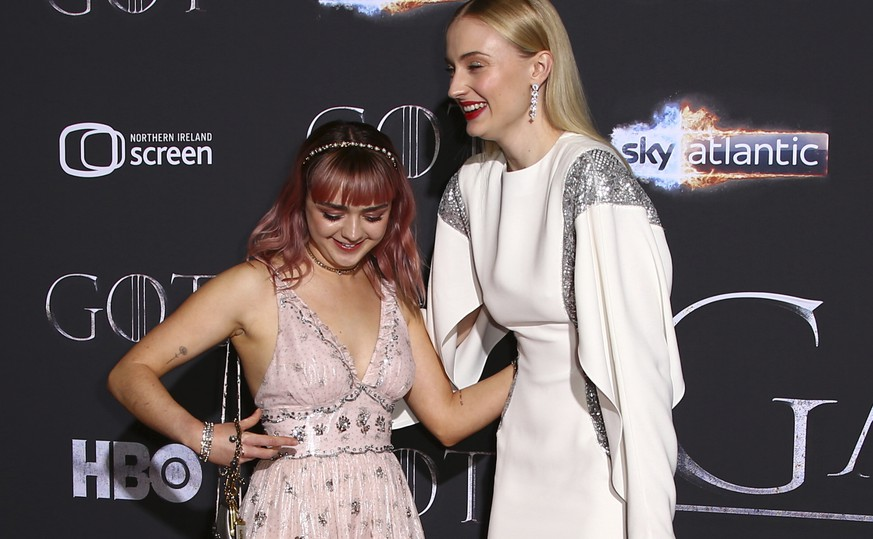 Actresses Maisie Williams, left, and Sophie Turner pose for photographers at the premiere of season eight of the television show 'Game of Thrones' in Belfast, Northern Ireland, Friday, April 12, 2019. (Photo by Joel C Ryan/Invision/AP)