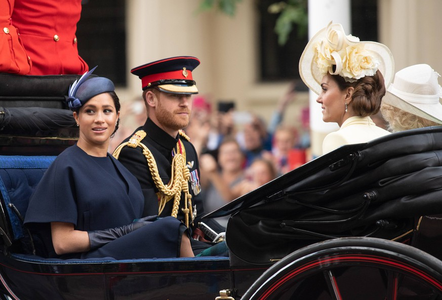 Trooping the Colour Meghan, Duchess of Sussex rides in an open carriage with Prince Harry, Duke of Sussex and Catherine, Duchess of Cambridge during Trooping the Colour in London on June 08, 2019. This was her first public engagement since the birth of her son Archie. PUBLICATIONxINxGERxSUIxAUTxONLY Copyright: xAnwarxHusseinx 43434047