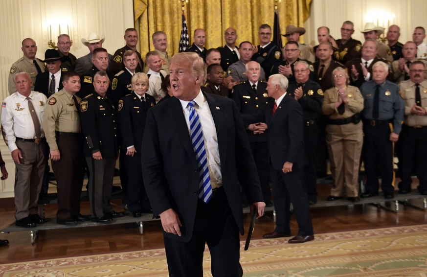 President Donald Trump responds to a reporters question during an event with sheriffs in the East Room of the White House in Washington, Wednesday, Sept. 5, 2018. (AP Photo/Susan Walsh)