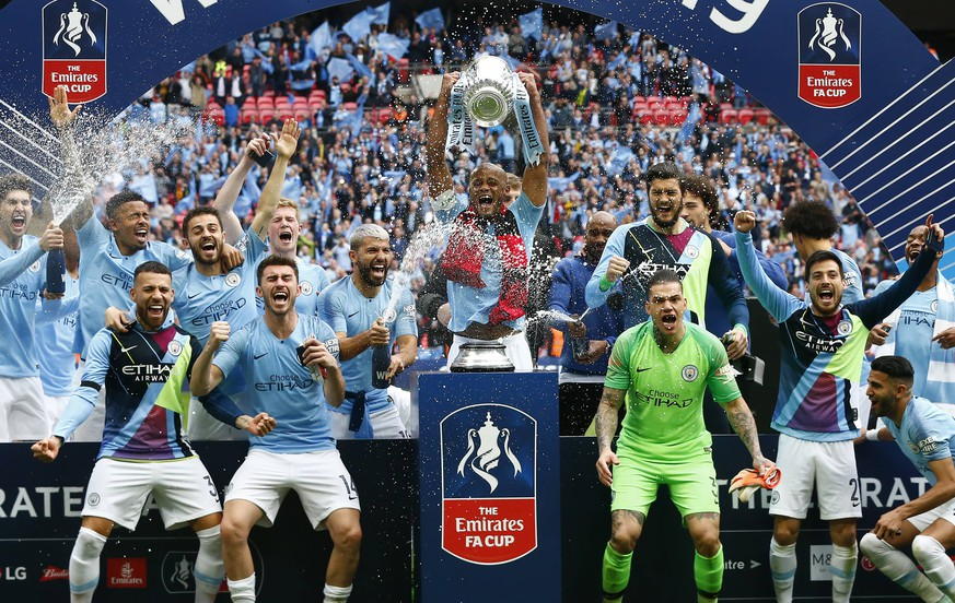 May 18, 2019 - London, England, United Kingdom - Manchester City s Vincent Kompany with Trophy.during FA Cup Final match between Manchester City and Watford at Wembley stadium, London on 18 May 2019., games or single club/league/player publications/services. Manchester City v Watford - FA Cup Final PUBLICATIONxINxGERxSUIxAUTxONLY - ZUMAn230 20190518_zaa_n230_993 Copyright: xActionxFotoxSportx