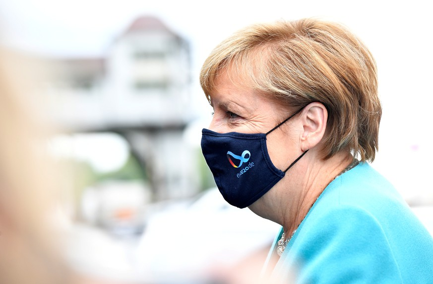 German Chancellor Angela Merkel wears a protective mask as she arrives for a meeting with the leadership of the conservative CDU/CSU parliamentary group, in Berlin, Germany September 2, 2020. Tobias Schwarz/Pool via REUTERS