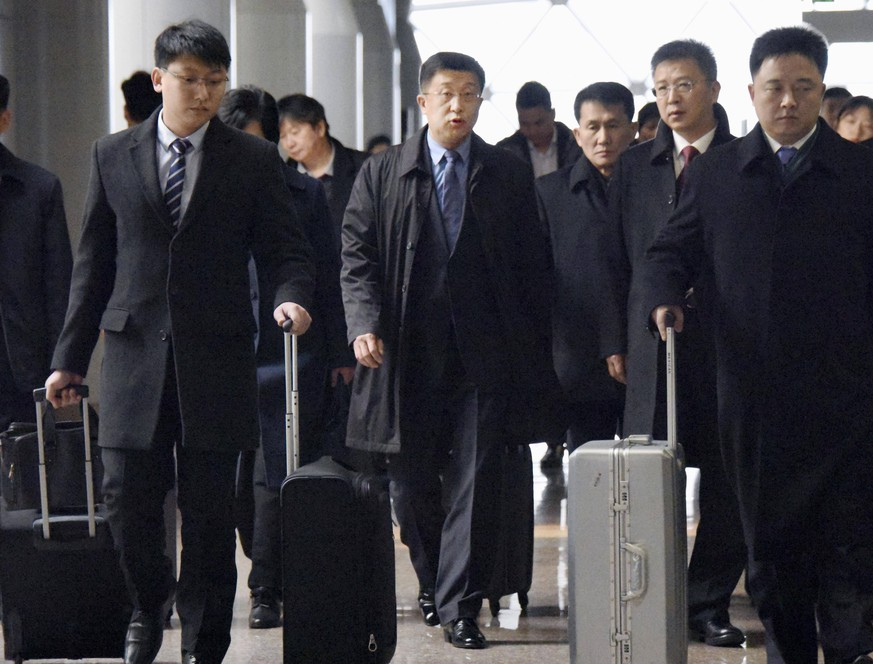 N. Korea s negotiator with U.S. Kim Hyok Chol (C), North Korea s interlocutor leading negotiations with the Untied States, arrives at Beijing s international airport on Feb. 19, 2019, on his way to the Vietnamese capital Hanoi, where the second summit between North Korean leader Kim Jong Un and U.S. President Donald Trump is scheduled to be held Feb. 27-28. PUBLICATIONxINxGERxSUIxAUTxHUNxONLY