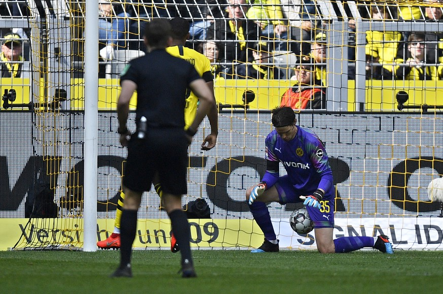 Dortmund goalkeeper Marwin Hitz lets a shot from Duesseldorf's Oliver Fink slip between his legs to tie the game 1-1 during the German Bundesliga soccer match between Borussia Dortmund and Fortuna Duesseldorf in Dortmund, Germany, Saturday, May 11, 2019. (AP Photo/Martin Meissner)
