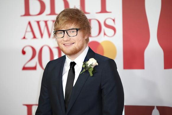 FILE - In this Feb. 21, 2018 file photo, singer Ed Sheeran poses for photographers upon arrival at the Brit Awards 2018 in London. Sheeran and his fiancé stopped in at Tommy Sullivan's Cafe in Branford, Conn., following a wedding Friday, Sept. 28. Pub owner Maeve Sullivan says the