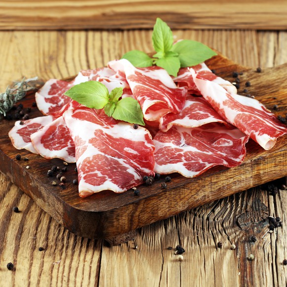 Italian sliced cured coppa with spices. Raw ham. Crudo or jamon.