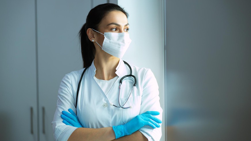 Caucasian pediatrician with stethoscope is waiting for patient stock photo. Pediatrics concept