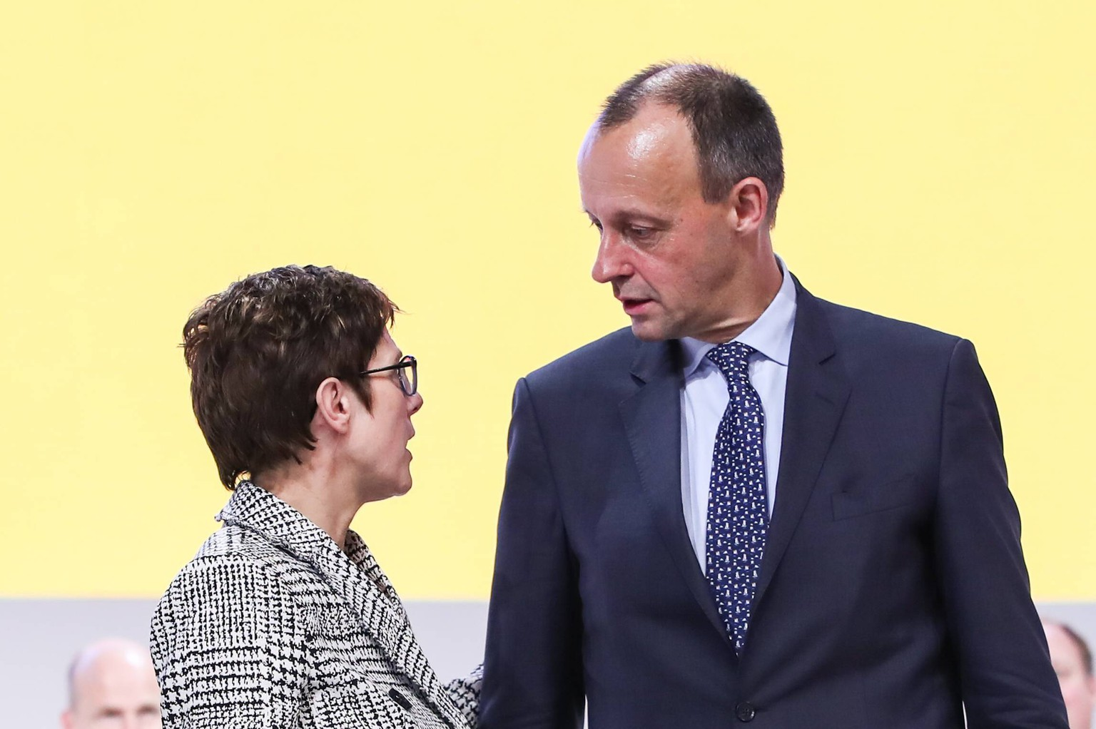 181208 -- HAMBURG, Dec. 8, 2018 -- Newly-elected chairperson of Germany s Christian Democratic Union CDU Annegret Kramp-Karrenbauer L talks with Friedrich Merz during the party conference of CDU in Hamburg, Germany, on Dec. 7, 2018. Annegret Kramp-Karrenbauer was elected new chairperson of Germany s ruling Christian Democratic Union CDU at the party s 31st national congress here on Friday, succeeding Chancellor Angela Merkel who has led the party for 18 years.  GERMANY-HAMBURG-CDU-PARTY CONFERENCE-KRAMP-KARRENBAUER ShanxYuqi PUBLICATIONxNOTxINxCHN