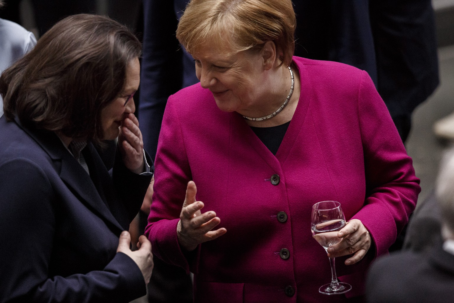 BERLIN, GERMANY - MARCH 12: German Chancellor and Chairwoman of the German Christian Democrats (CDU) Angela Merkel (R) and Andrea Nahles, party leader of the German Social Democrats (SPD), talk after the signing the coalition contract between the three parties to create the next German government on March 12, 2018 in Berlin, Germany. Today's signing follow months of arduous negotiations following federal elections last September. Merkel is due to be elected as chancellor for her fourth term in a session of the Bundestag this coming Wednesday. (Photo by Carsten Koall/Getty Images)