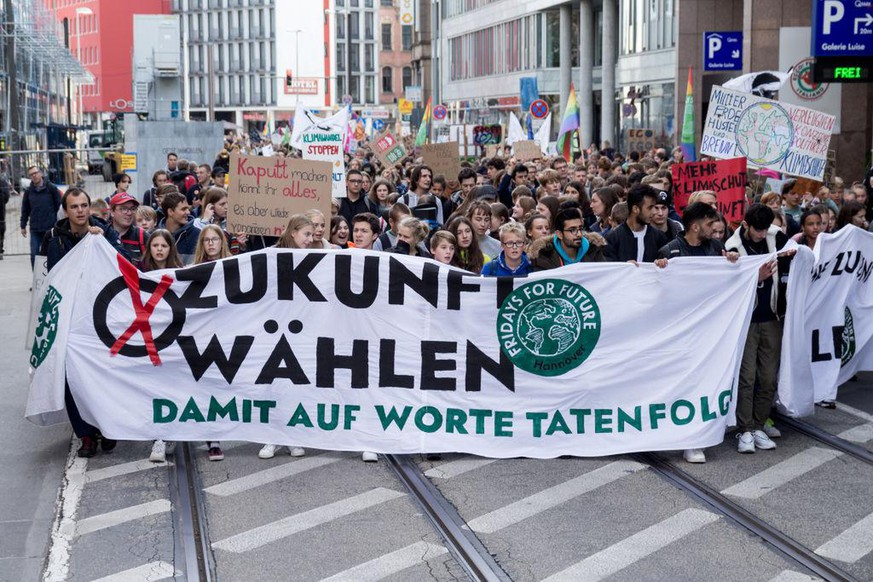 On the occasion of the Lord Mayor election next Sunday, the 'Fridays for Future' movement put its demo on 25 October 2019 in Hannover, Germany, under the motto 'Vote for the future'. They again addressed their demands for consistent climate protection to the city's politicians. Before the pupils Fridays for future demonstration officially start, hundreds of students came together in front of the university to join the demonstration in the city center. (Photo by Peter Niedung/NurPhoto via Getty Images)