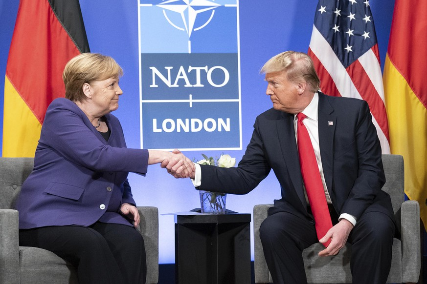 December 4, 2019, Watford, England, United Kingdom: U.S. President Donald Trump and German Chancellor Angela Merkel hold a bilateral meeting on the sidelines of the NATO Summit December 4, 2019 in Watford, Hertfordshire, United Kingdom. Watford United Kingdom PUBLICATIONxINxGERxSUIxAUTxONLY - ZUMAp138 20191204zaap138019 Copyright: xShealahxCraighead/Planetpixx