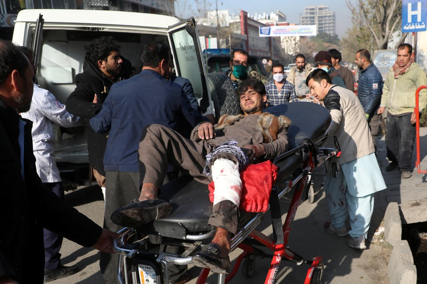 An injured man is carried to a hospital after rockets hit residential areas in Kabul, Afghanistan November 21, 2020. REUTERS/Omar Sobhani