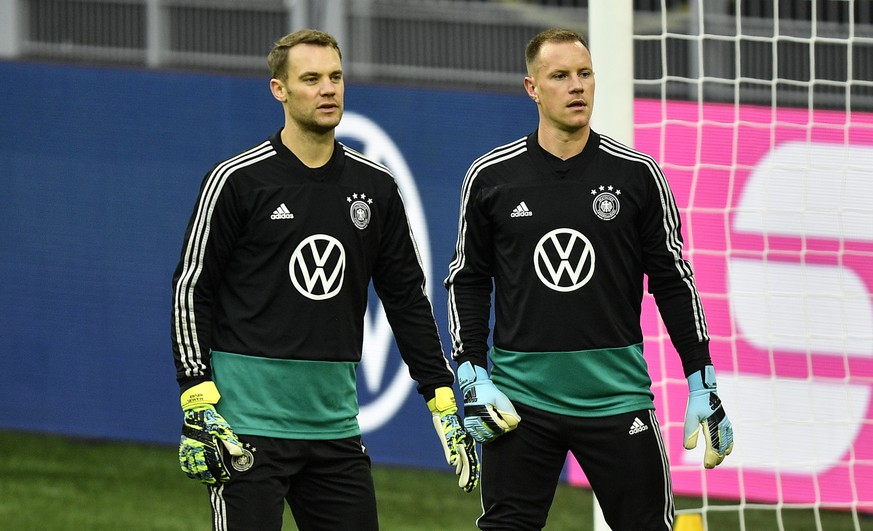 Germany's goalkeepers Marc-Andre ter Stegen, right, and Manuel Neuer exercise during a training session of the national team on Tuesday, Oct. 8, 2019, prior a friendly soccer match between Germany and Argentina in Dortmund, Germany. (AP Photo/Martin Meissner)