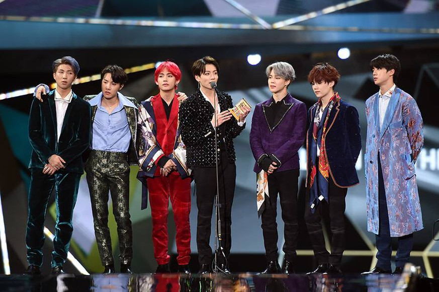 Members of South Korean boy band BTS, also known as the Bangtan Boys, pose with their trophy during the 2018 Mnet Asian Music Awards or MAMA in Hong Kong, China, 14 December 2018. BTS boys hot up 2018 Mnet Asian Music Awards in Hong Kong PUBLICATIONxINxGERxAUTxSUIxONLY 20181215_66774