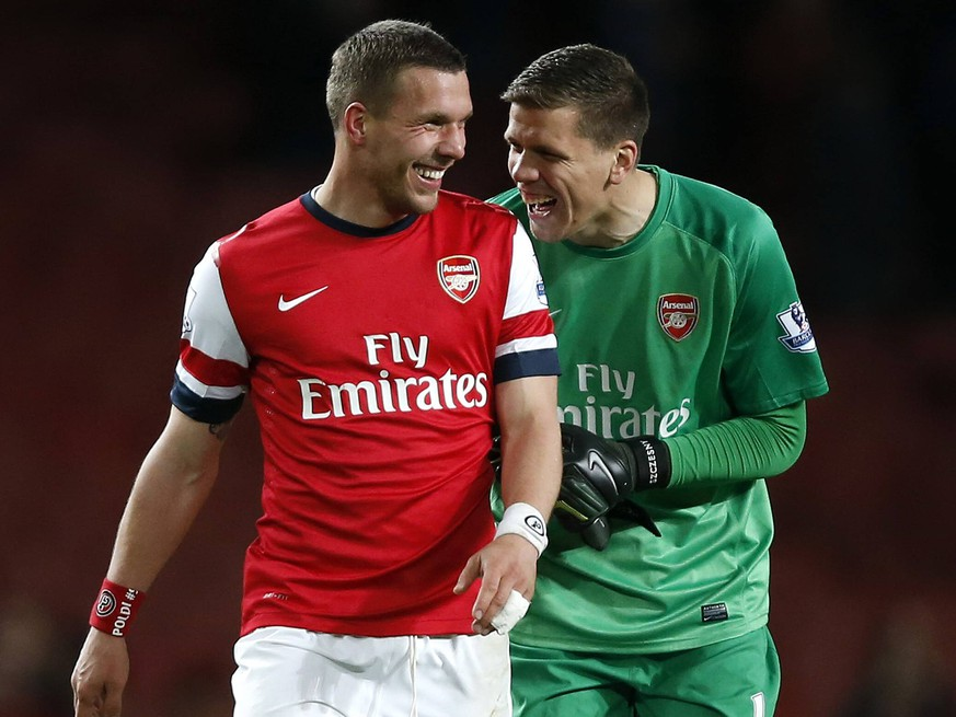 LONDON, April 15, 2014 (Xinhua) -- Lukas Podolski (L) of Arsenal celebrates with goalie Wojciech Szczesny after the Barclays Premier League match between Arsenal and West Ham United at Emirates Stadium in London, Britain on April 15, 2014. Arsenal won 3-1.(Xinhua/Wang Lili)    PUBLICATIONxNOTxINxCHN