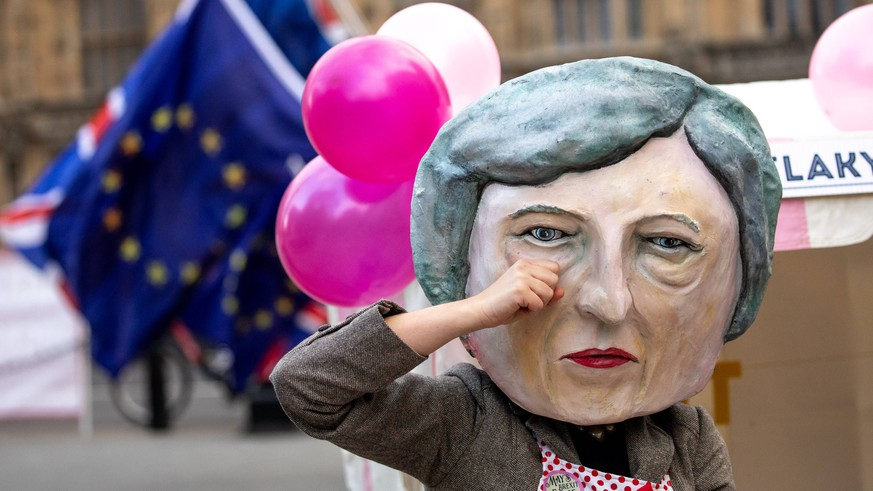 December 10, 2018 - London, London, UK - London, UK. A person dressed as British Prime Minister Theresa May gives away fudge outside the Houses of Parliament, as part of a photocall hosted by Avaaz. Tomorrow MPs will vote on May s withdrawal deal. London UK PUBLICATIONxINxGERxSUIxAUTxONLY - ZUMAl94_ 20181210_zaf_l94_018 Copyright: xTomxNicholsonx