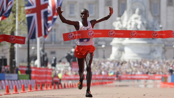 Kenya's Eliud Kipchoge reacts after crossing the finish line to win the Men's race in the London Marathon in central London, Sunday, April 22, 2018.(AP Photo/Kirsty Wigglesworth)