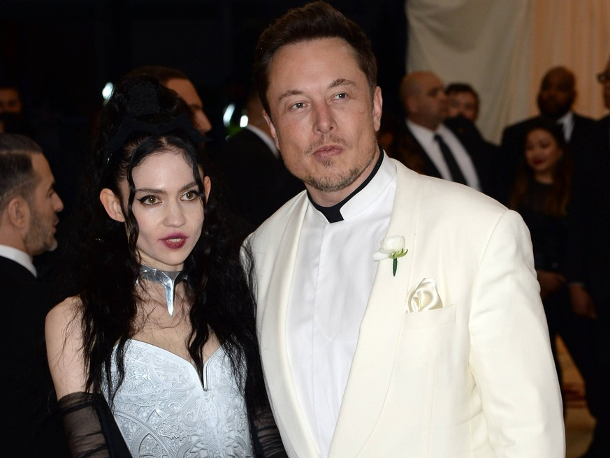 May 7, 2018 - New York, New York, United States - Elon Musk and Grimes arriving at Heavenly Bodies: Fashion & The Catholic Imagination Costume Institute Gala at the Metropolitan Museum of Art on May 7, 2018 in New York City New York United States *** May 7 2018 New York New York United States Elon Musk and Grimes arriving at Heavenly Bodies Fashion The Catholic Imagination Costume Institute Gala at the Metropolitan Museum of Art on May 7 2018 in New York City New York United States PUBLICATIONxINxGERxSUIxAUTxONLY - ZUMAny1 20180507zafny1573 Copyright: xKristinxCallahanx