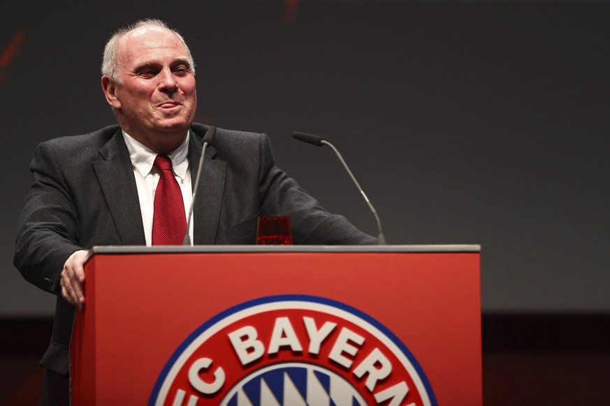 Bayern Munich president Uli Hoeness smiles on the podium during his speech and his farewell at the annual general meeting of FC Bayern Munich soccer club in Munich, Germany, Friday, Nov. 15, 2019. (AP Photo/Matthias Schrader)