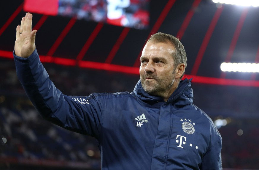 Bayern's head coach Hans Flick reacts before the German Bundesliga first devision soccer match between FC Bayern Munich and bayer Leverkusen 04 in Munich, Germany, Saturday, Nov. 30, 2019. (AP Photo/Matthias Schrader)