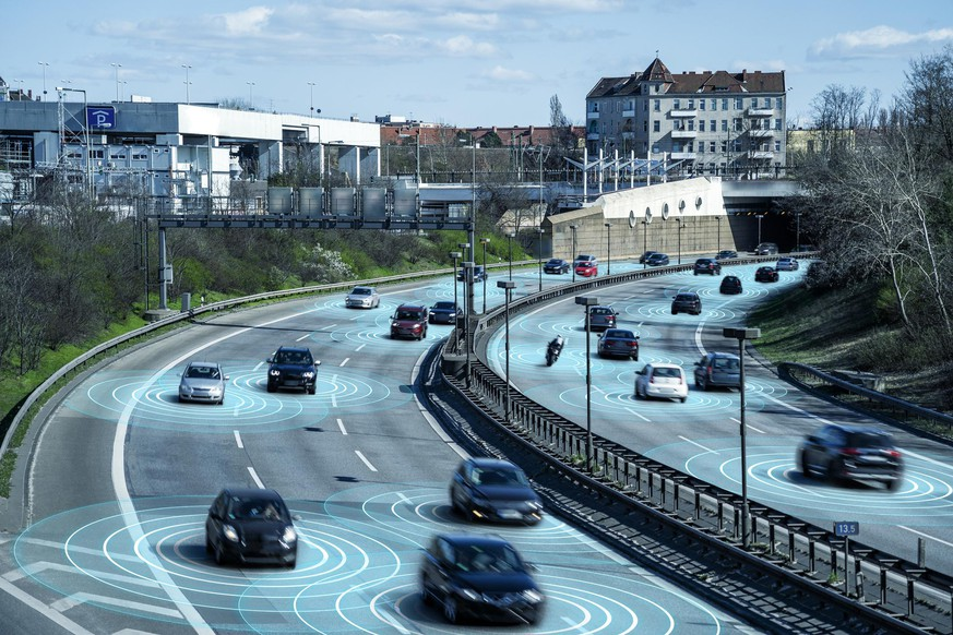 Self driving autonomous cars on multi lane highway. The cars are using radar sensors, wireless communication and artificial intelligence to navigate and communicate with each other.