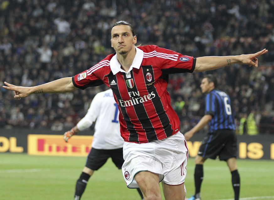 FILE - In this Sunday, May 6, 2012 filer, AC Milan forward Zlatan Ibrahimovic, of Sweden, celebrates after scoring during the Serie A soccer match between Inter Milan and AC MIlan at the San Siro stadium in Milan, Italy. Ibrahimovic will join AC Milan, the Milanese club announced Friday, Dec. 27, 2019 on its official twitter page. (AP Photo/Antonio Calanni, File)