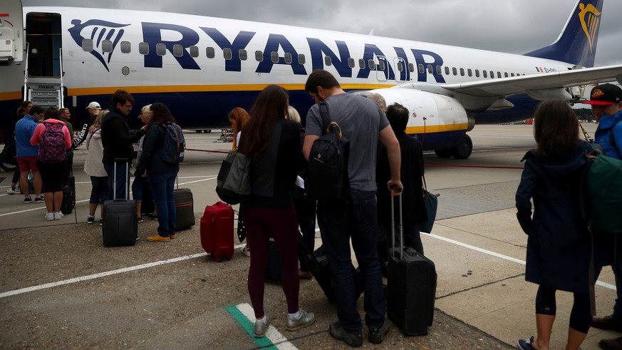 FILE PHOTO: Passengers wait to board a Ryanair flight at Gatwick Airport in London, Britain. Aug 23, 2018. REUTERS/Hannah McKay/File Photo