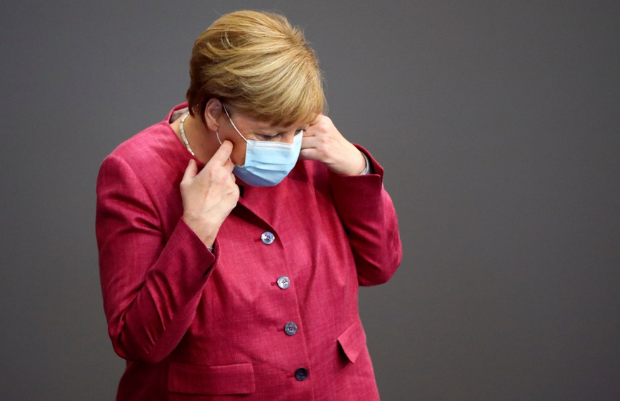 German Chancellor Angela Merkel wearing a face mask attends a session of the German lower house of parliament Bundestag, in Berlin, Germany, September 30, 2020. REUTERS/Hannibal Hanschke