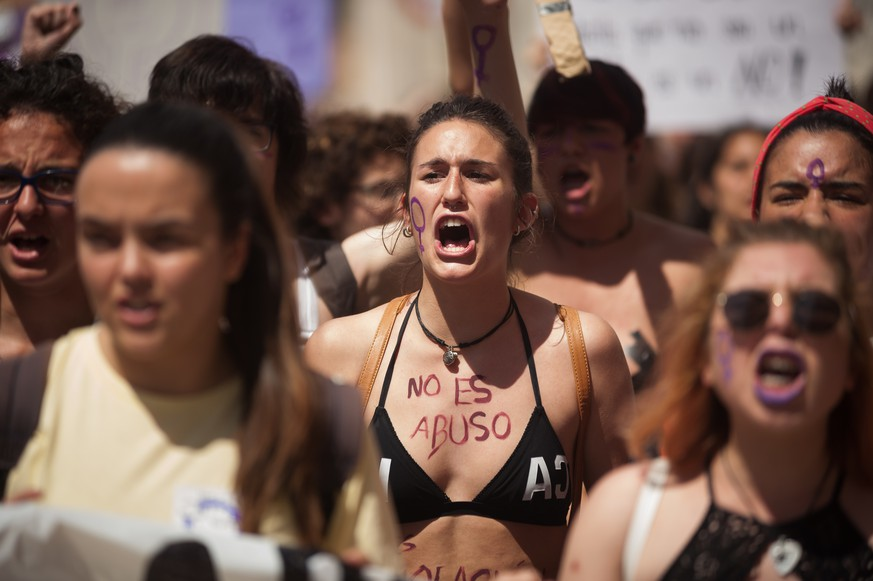 May 10, 2018 - Malaga, Spain - A protester with her body painted with the words: ''It is not abuse, it is rape'' takes part in a demonstration during a feminist student strike against the sentence of 9 years in prison to five men (known as 'La Manada' or Wolf Pack) accused of the group rape of an 18-year-old woman during the San Fermin Festival in 2016 |