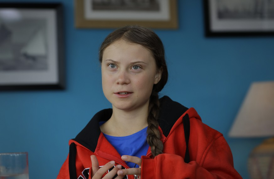 Greta Thunberg is interviewed by The Associated Press in Plymouth, England Tuesday, Aug. 13, 2019. Greta Thunberg, the 16-year-old climate change activist who has inspired student protests around the world, is heading to the United States this week - in a sailboat. (AP Photo/Kirsty Wigglesworth)