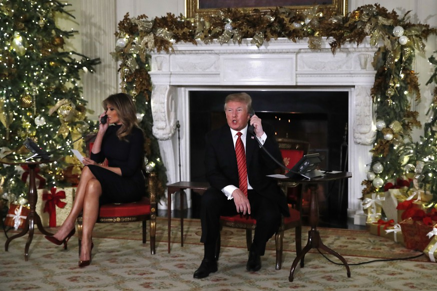 "President Donald Trump answers a question about the shutdown saying, ""Nothing new on the shutdown. We need more border security,"" in answer to a reporter's question as he and first lady Melania Trump each spoke on the phone sharing updates to track Santa's movements from the North American Aerospace Defense Command (NORAD) Santa Tracker on Christmas Eve, Monday, Dec. 24, 2018. (AP Photo/Jacquelyn Martin)"