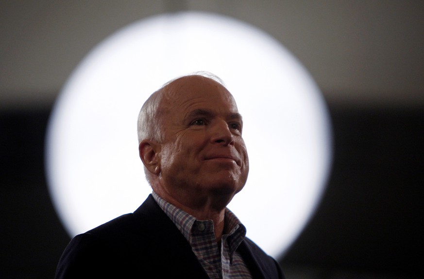 FILE PHOTO -  U.S. Republican presidential nominee Sen. John McCain (R-AZ) smiles during a rally in Concord, North Carolina October 18, 2008. REUTERS/Carlos Barria/File Photo