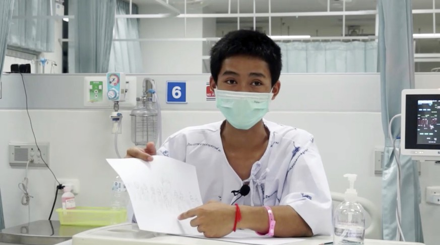 This image made from a video taken on July 13, 2018 and released by Chiang Rai Prachanukroh Hospital, shows Adul Sam-on, one of the 12 boys rescued from the flooded cave, in their hospital room at Chiang Rai Prachanukroh Hospital in Chiang Rai province, northern Thailand. The video was shown during a press conference at the hospital Saturday, July 14, 2018. (Chiang Rai Prachanukroh Hospital via AP)