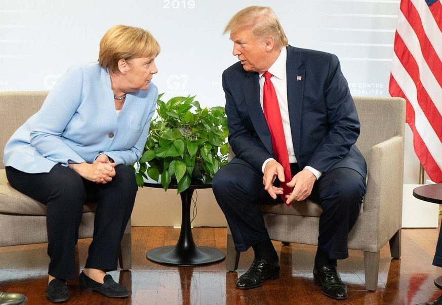 August 26, 2019 - Biarritz, France - US President DONALD TRUMP and ANGELA MERKEL at the G7 Summit in Biarritz, France Biarritz France PUBLICATIONxINxGERxSUIxAUTxONLY - ZUMAz03 20190826shaz03448 Copyright: xWhitexHousex