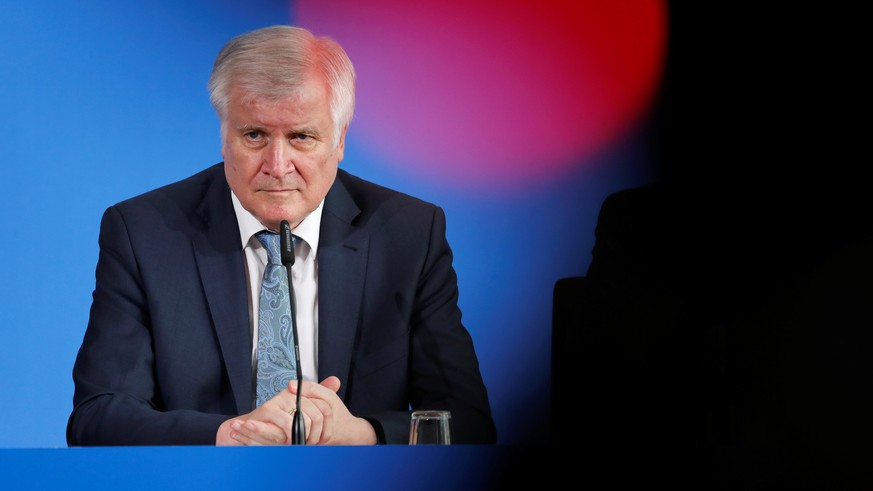 German Interior Minister Horst Seehofer attends a news conference a day after a man killed an 8-year-old boy by pushing him on to train tracks at Frankfurt's main train station, in Berlin, Germany July 30, 2019. REUTERS/Fabrizio Bensch