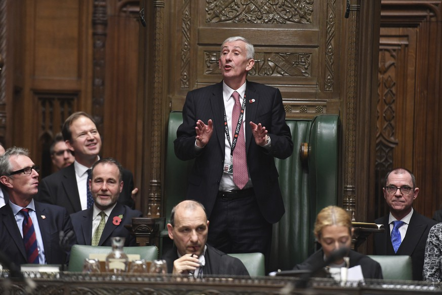 In this handout image provided by the House of Commons, new  Speaker of the House, Lindsay Hoyle, center, addresses lawmakers in the House of Commons, London, Monday, Nov. 4, 2019. British lawmakers elected Lindsay Hoyle as the new House of Commons speaker on Monday, after the tempestuous tenure of the influential but controversial John Bercow. (Jessica Taylor/House of Commons via AP)