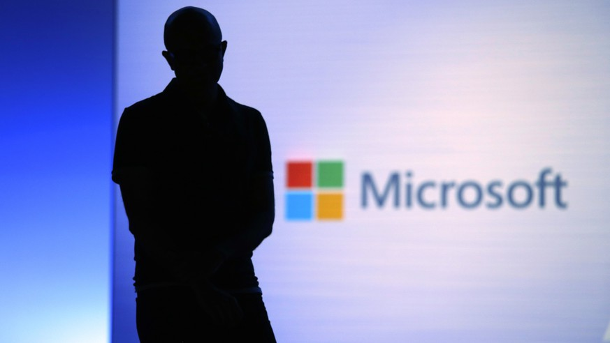 FILE- In this May 7, 2018, file photo Microsoft CEO Satya Nadella looks on during a video as he delivers the keynote address at Build, the company's annual conference for software developers in Seattle. Microsoft Corp. reports earnings Thursday, July 19, 2018. (AP Photo/Elaine Thompson, File)