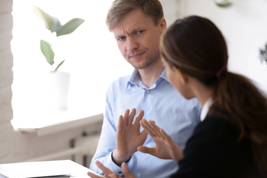 Annoyed man discussing working moments and disagreed with colleague. Hr manager showing with hands gesture protest and rejection want to finish unsuccessful job interview. Bad first impression concept