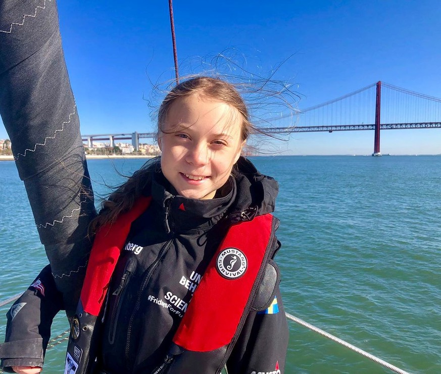 Climate change activist Greta Thunberg poses on the yacht, La Vagabonde, before arriving in Lisbon, Portgual December 3, 2019 in this image obtained from social media. Greta Thunberg Media via REUTERS  ATTENTION EDITORS - THIS IMAGE HAS BEEN SUPPLIED BY A THIRD PARTY. MANDATORY CREDIT. NO RESALES. NO ARCHIVES