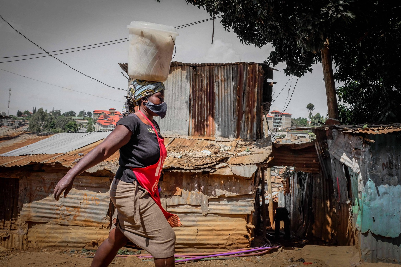 June 4, 2020, Nairobi, Kenya: A mobile business woman marching past the busy streets protected in her safety Face Mask. Nairobi Kenya - ZUMAd156 20200604zipd156002 Copyright: xDonwilsonxOdhiambox
