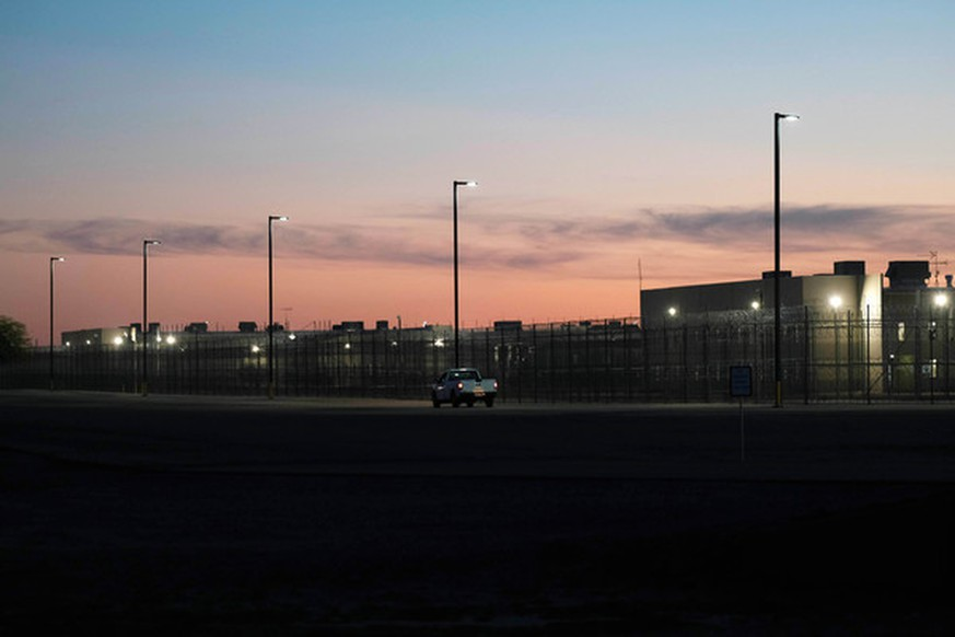 November 16, 2018 - Eloy, Arizona, USA - Candlelight vigil at the Eloy Detention Center in Eloy, Arizona. Eloy is a private prison owned and operated by CoreCivic under a contract with US Immigration and Customs Enforcement. Illegal immigrants are held at the facility while they await a hearing before a judge . The protest was organized by the Puente Human Rights movement to highlight conditions at the prison and the illegal incarceration of detainees. Supporters called for the abolishment of I.C.E and rights of migrants |